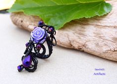 Black wire wrapped Goth Victorian style adjustable ring. €25,00, via Etsy.