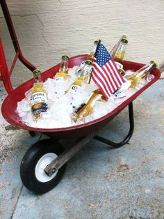 Fun way to ice down drinks for a 4th of July celebration!   It would be a cute way to cool down a bunch of water bottles.