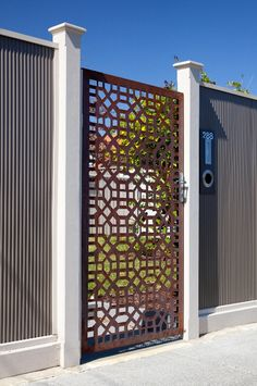 outdoor metal art. Creative laser cut gates with rustic finish by Entanglements
