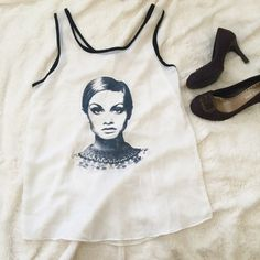 """White Sheer Chiffon Top with Twiggy Print White sheer chiffon tank top with print •  Like new with minor stains in the back as shown in the photo • Size: S • Length: 29"""".  ‼️My closet closing on June 19 for moving abroad, shop now!  No trades or holds or ️aypal ✅ Reasonable offers only ✅ Use """"Offer"""" button  Bundle for 15% off ❤️  Fast shipping ( in 1-2 days) Boutique Tops"""
