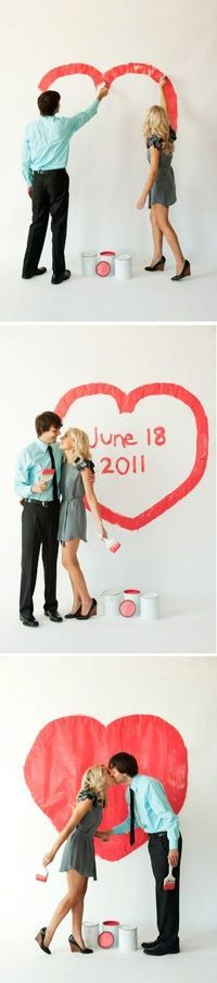 Cute engagement or save-the-date photo shoot idea - paint a heart!