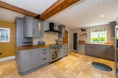 Check out this property for sale on Rightmove! Grey Painted Walls, Painted Wood, Exposed Brick Walls, Exposed Beams, Log Burning Stoves, Window Seat Storage, Multi Fuel Stove, Paved Patio, Bespoke Kitchens