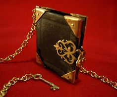 Black Leather and Brass Locket Necklace with Heart Padlock and Key - Book of Secrets - $83 by Skadi Jewellery Design  As a lover of fairytales and books in general I was compelled to make this antique style book locket pendant. Hidden inside are blank pages where you can add your own story. It would also make a wonderful personalised gift for a book loving loved one.https://www.cityblis.com/9137/item/8372   Entirely handmade in black leather and brass ...