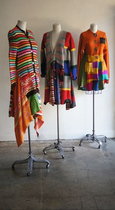 Colorful group of sweaters in three different lengths.