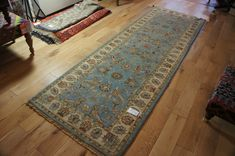 Hand Knotted Agra Ziegler Runner from India. Length: 250.0cm by Width: 80.0cm. Now only £499 (Was £575) at https://www.olneyrugs.co.uk/shop/runners-for-sale/indian-agra-ziegler-18393.html    View our charming array of wall hanging rugs, footstools and Kilim cushions at www.olneyrugs.co.uk