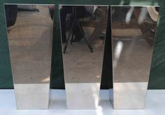 3 polished steelsquare planters, great condition, suitable for indoors or out, 40cm square x 90 tall