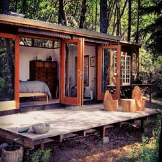 exactly this!!!   I love the doors, needs a bigger deck.....where can I get this?  A Cabin by the Lake
