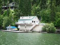 Coeur d'Alene Lake, Cottonwood Bay, 100' frontage, Main Home: 3 bdrms, 1 bath, 1724 sq ft; Guest Cabin: 1 bdrm, 1 bath, 560 sq ft. 180 degree lake views. Spring water system, updated septic system, furnished, tramway for easy access.