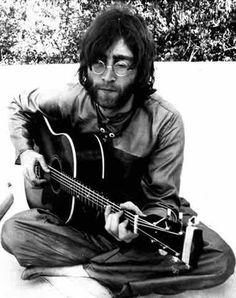 John Lennon plays