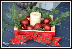 Trash to Treasure Christmas Christmas decorating at it's cheapest. I made this great front porch Christmas decoration out of a clementine crate, some ribbon and free pine branches! Free, free, free!