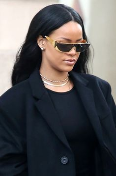 BRB… just following Rihanna into the future with her wraparound Dior gold Terminator sunglasses
