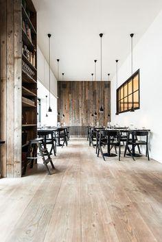 Wood plank floors and walls. White walls. Black Windows