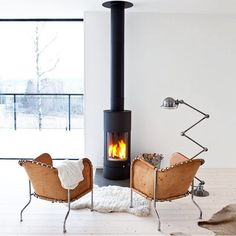"""""""Downtime by the fire... #regramlove @1stdibs #modern #holiday #fireplace #cozy"""""""