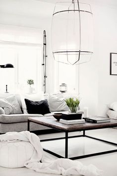 Make a white-and-black color palette pop by mixing textures throughout the room.