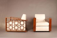 Jean Royere, Pair of upholstered white chairs in mahogany, c. 1950, 30H x 29.75W x 37D inches