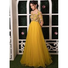 Yellow net embroidered wedding gown - Fabric :Two layerd Net + banglori silk gown with thread & zari work both side( semi stich upto 44 Meter flairFloor touch lengthYellow net embroidered wedding gown - Fabric :Two layerd Net + banglori silk gown w Gown Dress Party Wear, Party Wear Long Gowns, Party Wear Indian Dresses, Long Gown Dress, Designer Party Wear Dresses, Indian Gowns Dresses, Indian Fashion Dresses, Long Frock, Net Dresses