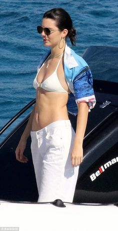 Model behaviour: Kendall Jenner and Bella Hadid showcased their killer abs in barely-there bikini tops as they took to the water while on holiday in bikini