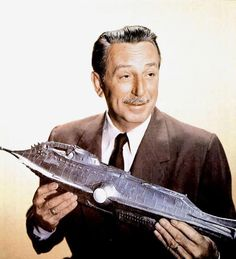 Walt Disney with a model of the Nautilus from his 1954 film 20,000 Leagues Under the Sea. Adapted from the book by Jules Verne, it was the first science fiction film produced by Walt Disney Productions, as well as the only science-fiction film produced by Walt Disney himself.
