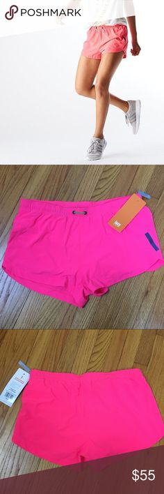 LUCY Revolution Run 3in Woven Shorts Bright Pink LUCY Revolution Run 3in Woven Shorts Brilliant Pink Lucy stretch lux light fabric - quick drying, packable 4-way stretch woven fabric. Reflective l-bar for visibility. Built-in basket liner. New with tags. **brighter than stock image, true to image of actual product** Size: large Waist: 17.75in Lucy Shorts