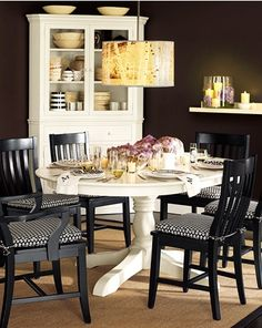 Like mixing colors ... maybe black table and white chairs instead. Or wood table and white or black chairs.