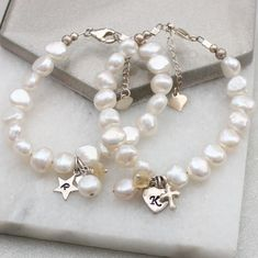 This beautiful white pearl bracelet is personalised with her initial on a sterling silver charm and a November birthstone gemstone for a little girl. A gorgeous Christening gift. Gemstone Bracelets, Pearl Bracelet, Gemstone Necklace, Crystal Necklace, Birthstone Charms, Birthstone Necklace, Topaz Jewelry, Jewellery, Pearl Stud Earrings