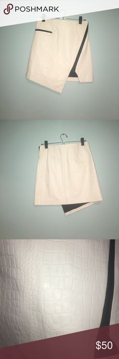 Asymmetrical white leather skirt White leather skirt, never worn. Genuine leather size 2 NOTE there is a faint mark on the rear side of the skirt, reasoning of the lowered price. jonathan simkhai Skirts Asymmetrical