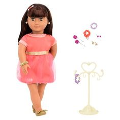 Accessorize your doll. Includes:<br>1 doll with earring holes, 1 dress, 1 headband, 1 pair of undies, 1 pair of shoes, 1 jewelry stand, 2 beaded bracelets, 2 rose hair pins, 1 wrap-around bracelet, 1 bracelet with charm, 2 pairs of gem earrings and 1 pair of rose earrings.<br>*Earrings are for doll only.