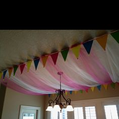 We had a tulle ceiling with cardstock flags.