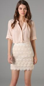 Love the masculine shape of the blouse with the slim feminine lace of the skirt