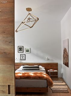 Second Time Around: Dufner Heighes Redesigns NoHo Model Apartment | Bec Brittain's chandelier hangs in the guest room.