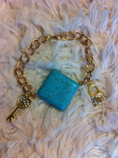 Turquoise stone with two charms and gold chain bracelet  on Etsy, $15.00