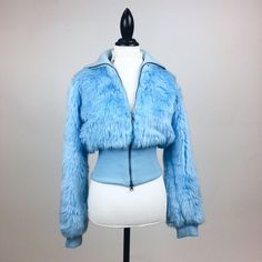 """90s cropped zip u baby blue faux fur coat. Exaggerated collar, metal zipper, and ribbed sweater hem. Great condition, seems unworn! Size S-M Bust: 36"""" Length: 20"""" Waist: 28""""-36"""" Sleeve: 24"""" Shoulder: 17"""""""