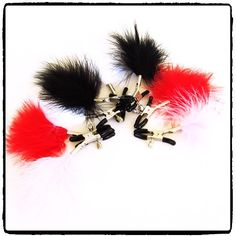 Lady Kink - Feathered Nipple Clamps R These spring jaw-nipple clamps adorned with a little bit of fluff for some ticklish fun offer an intense nipple sensation. Some Fun, Fancy, Spring