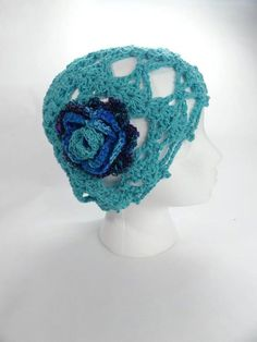 ‎20 % off any Hat.  Coupon code  PINTEREST  at checkout.        Lacy Crochet Hat in Aqua with crochet flower by toppytoppy on Etsy