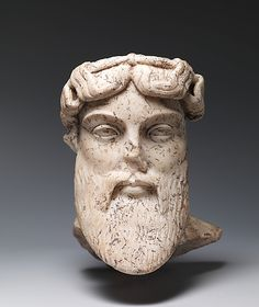 Roman imperial marble head of a god, probably Dionysus. 1st or 2nd century CE.