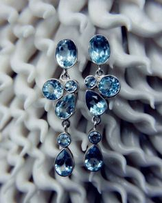 """These Blue Topaz """"Borealis"""" earrings are a contradition of """"casual"""" and a """"statement, Just as easily worn with your favorite casual t-shirt as a formal dress. These earrings are currently available on our Summer Sale. Sign up for our exclusive newsletter at plukka.com to access the necessary promo code and receive 30% Off!!"""