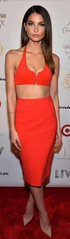 Who made Lily Aldridge's nude pumps, zipper top, red skirt, and jewelry that she wore in Miami on February 20, 2014?