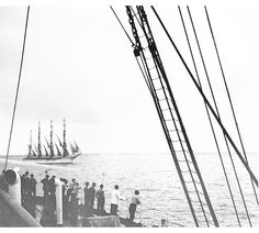 """""""Men watching approach of four-masted barque from deck of unidentified vessel"""" From MacAskill's """"The Liner She's a Lady, But"""" series. Photographer: W.R. MacAskill"""