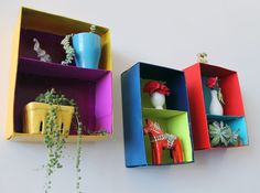 Shoebox Wall Art: Don't recycle those shoeboxes just yet! They can be transformed into colorful floating shelves with just a few coats of paint.
