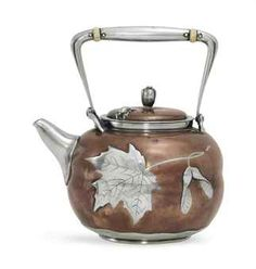 A SILVER AND COPPER TEA KETTLE  MARK OF TIFFANY & CO., NEW YORK, CIRCA 1880  32,500