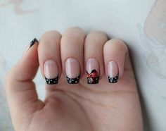 Black, red and white polka dot French tip with a red bow.
