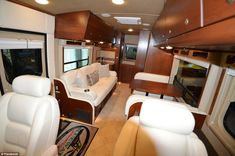 Luxury:The motor homes cost anywhere from $1.2 million to more than $2 million. Pre-owned vehicles start at around $200,000. Seen here is a smaller model, however fitted with the same luxury inclination, with white leather seats