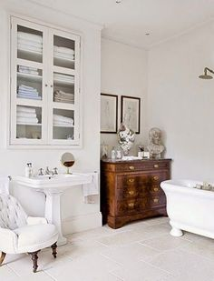 Repurposed Antiques - used for storage and as vanities in bathrooms - via Belclaire House: Antiques in the Ladies Room
