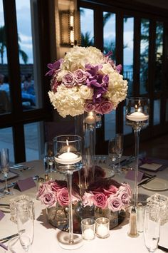 white, lavender and purple centerpiece with candles reception wedding flowers,  wedding decor, wedding flower centerpiece, wedding flower arrangement, add pic source on comment and we will update it. www.myfloweraffair.com can create this beautiful wedding flower look.