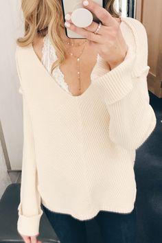 cute bralettes tp add to your winter wardrobe - white halter bralette under v-neck sweater.JPG