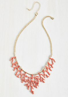 The way in which you accessorize is no joke, but it sure is fun! This gold and rich pink necklace, which is fashioned into the striking shape of a coral reef and flaunts a few accent rhinestones, displays your proclivity for making stunning statements.