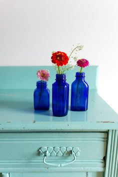 Hey, I found this really awesome Etsy listing at https://www.etsy.com/listing/242439192/vintage-blue-glass-apothecary-bottles