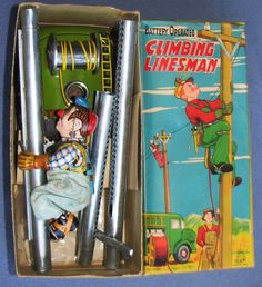 TPS Climbing Linesman. Batt Op Tin Toy from 50s/ebay