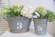 beachcomber: what to do with a galvanized tub... love the lettering and simple hydrangeas. Perfection!