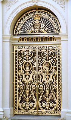 Love the design on this gold (brass) door. Perfect for Atelier grand entrance.